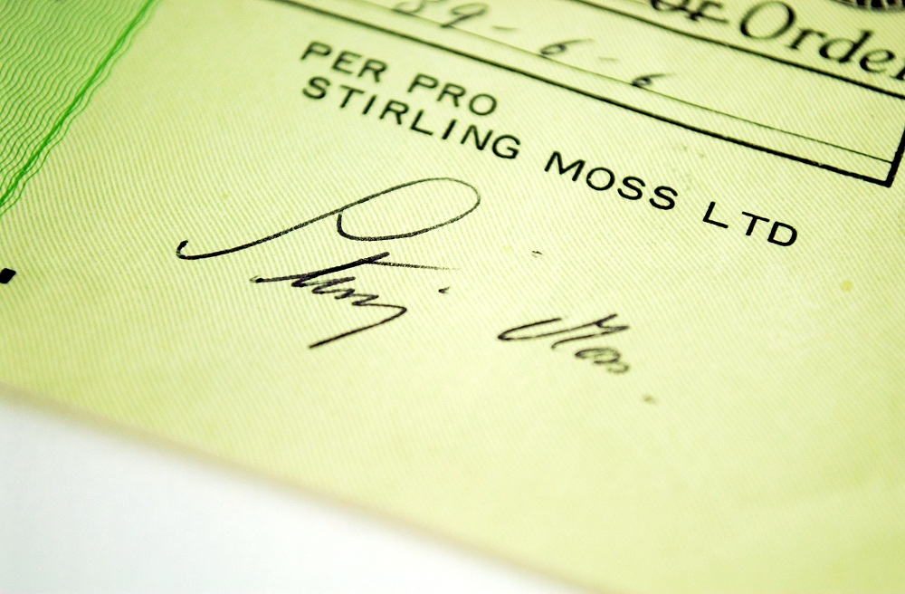Original Check signed by Sir Stirling Moss